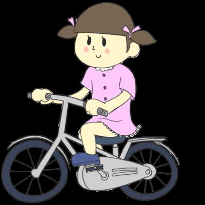 自転車に乗って走る女の子
