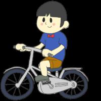 自転車に乗って走る男の子